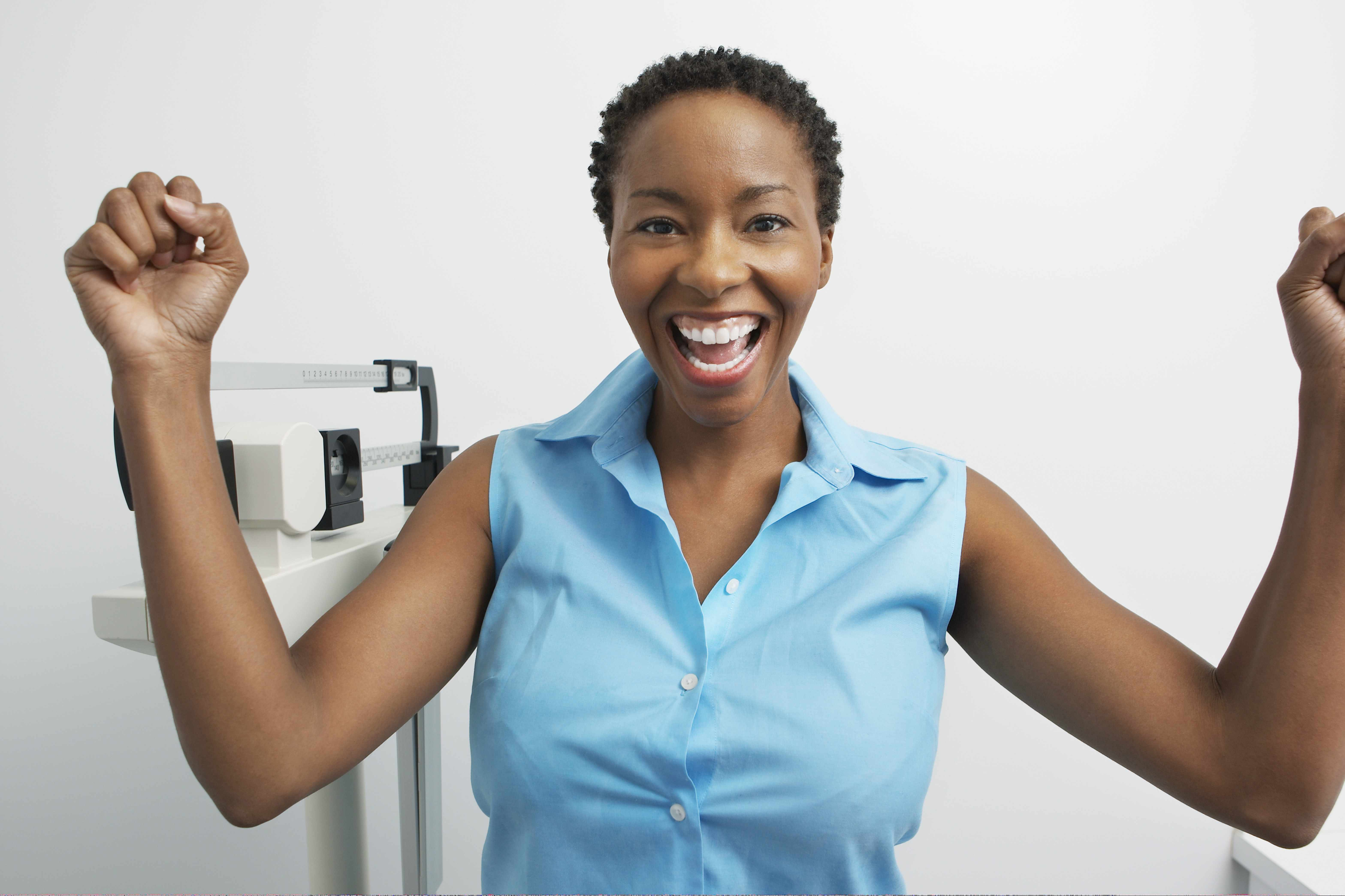 a woman celebrating health and weight loss