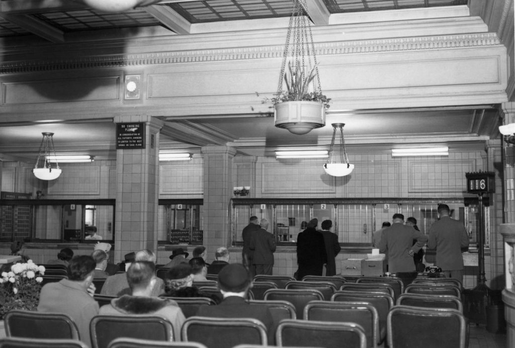 a 1953 photo of the patient registration desk in the Plummer Building