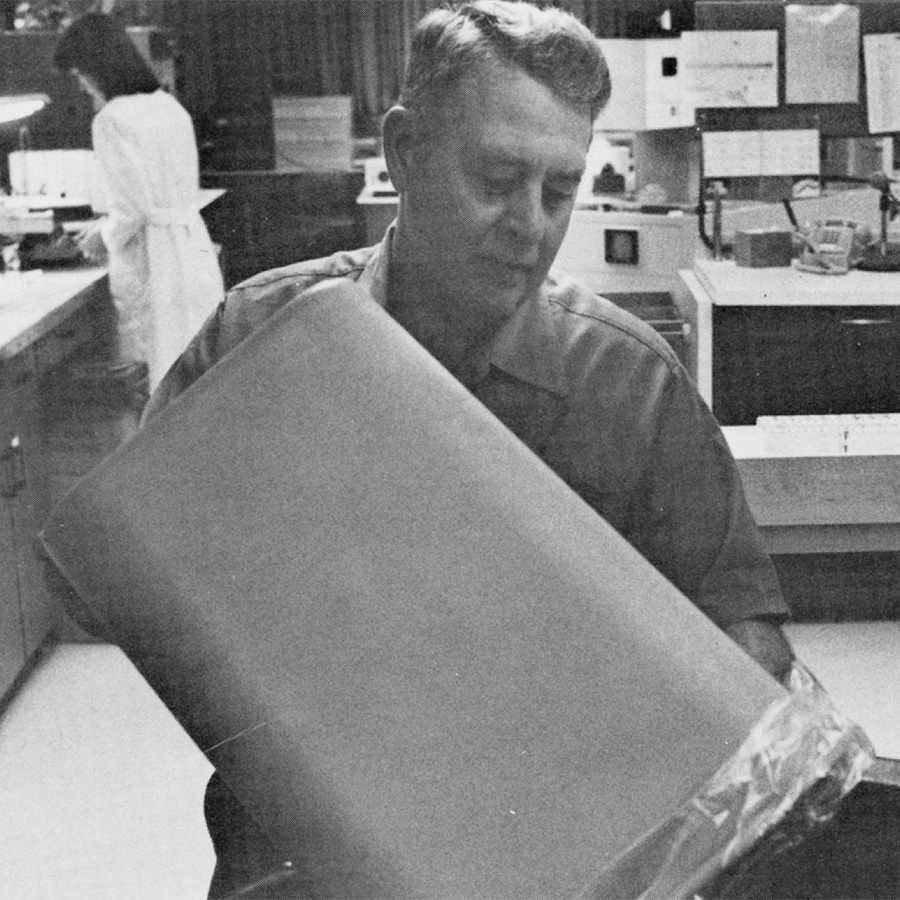 a 1981 photo of custodian Warren Hess working in the Hematology Lab