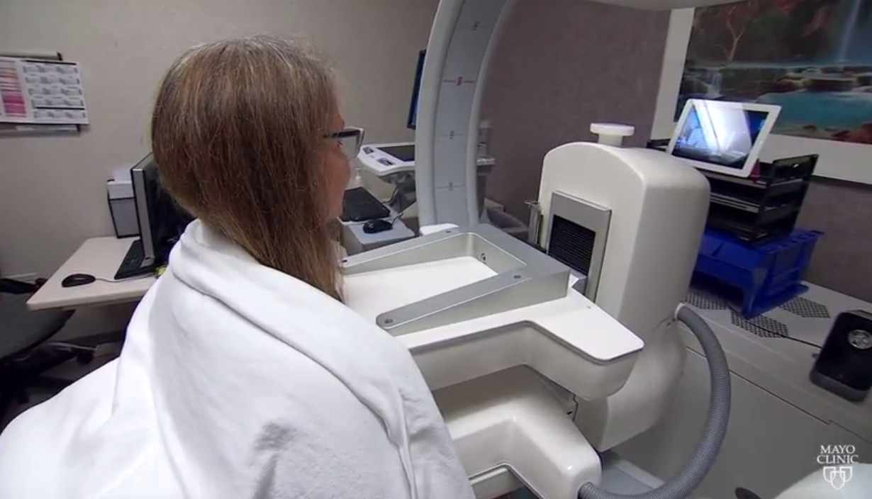 a patient having a breast cancer procedure called MBI - molecular breast imaging
