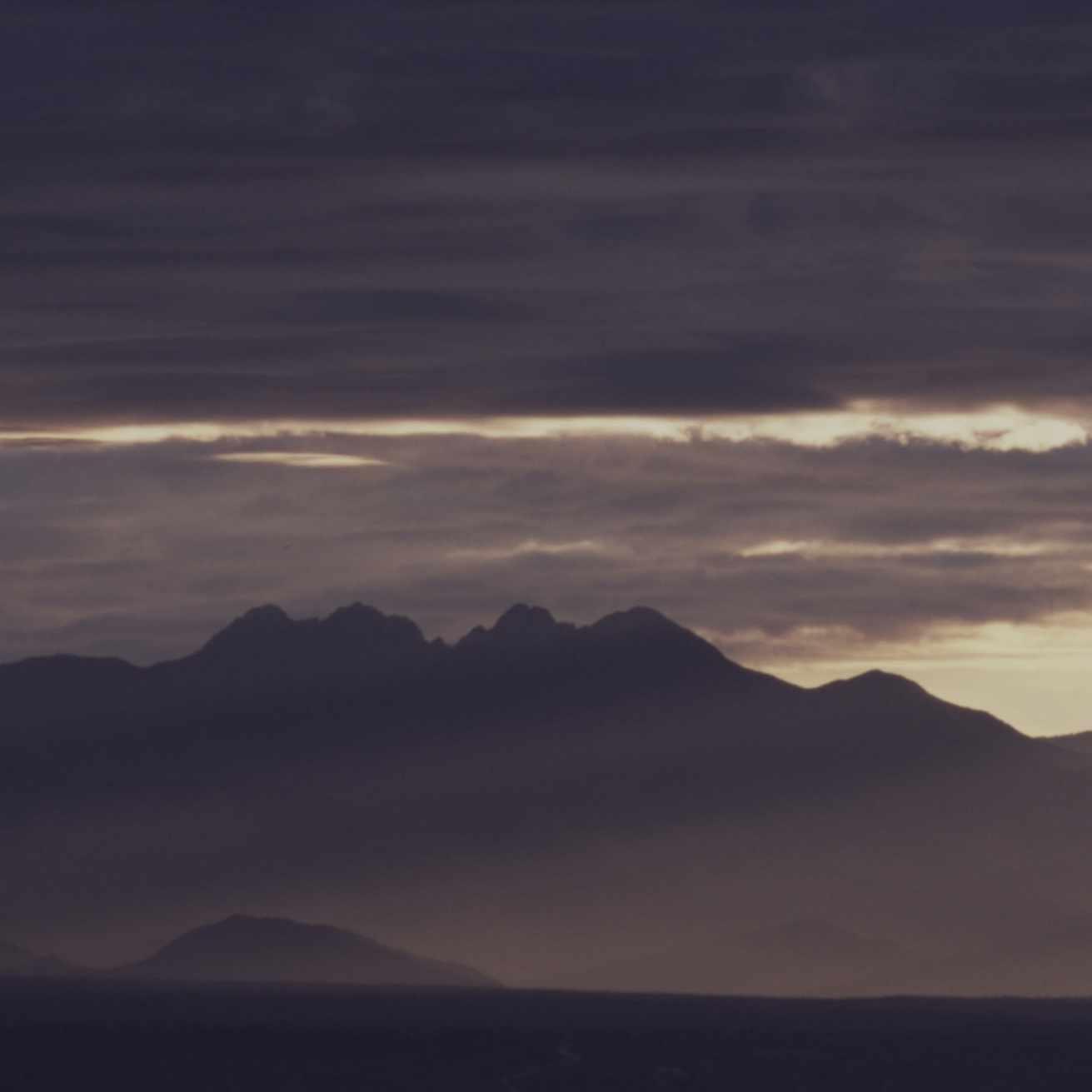 mountain alps against a dusky sky