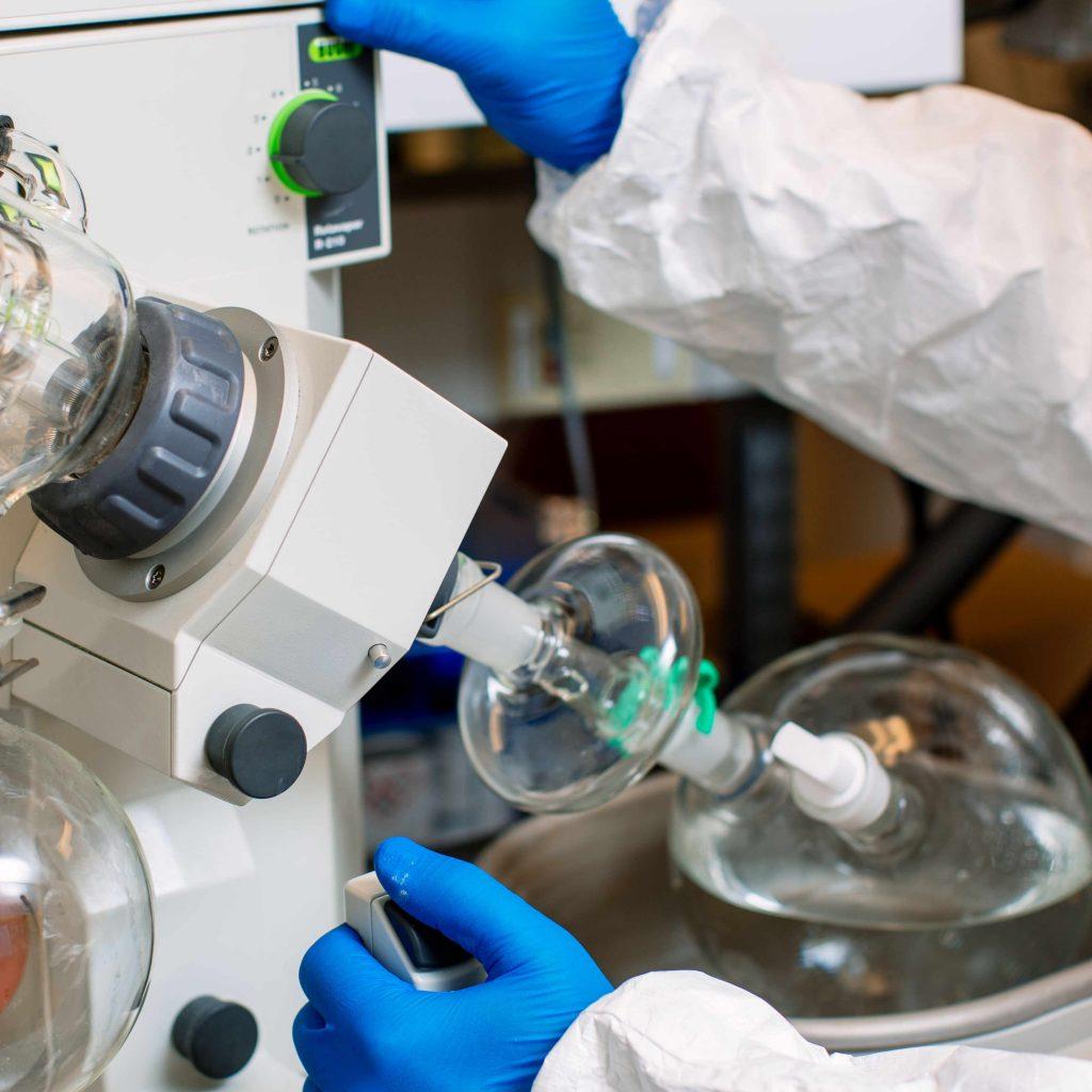 Scientist using biomedical equipment