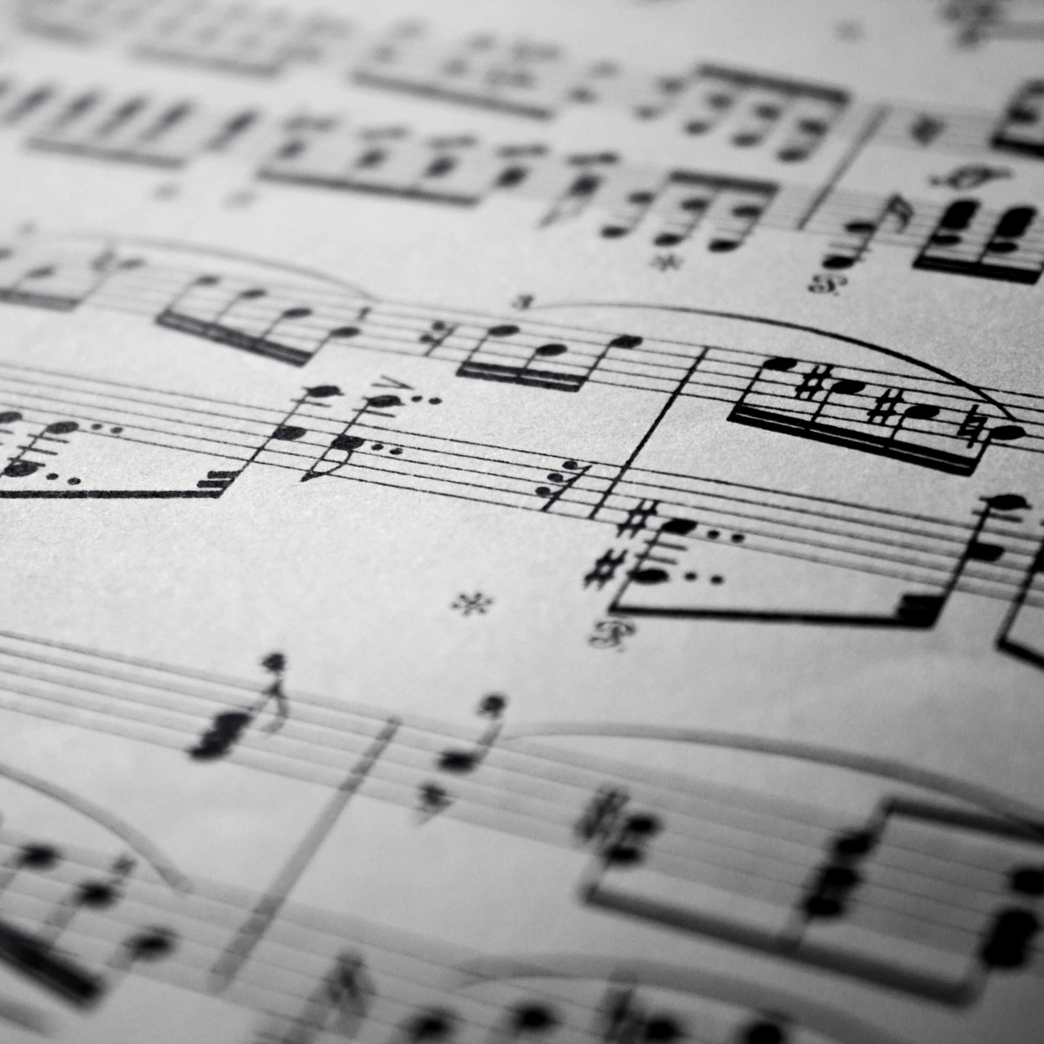 a close-up of musical notes on a sheet of music