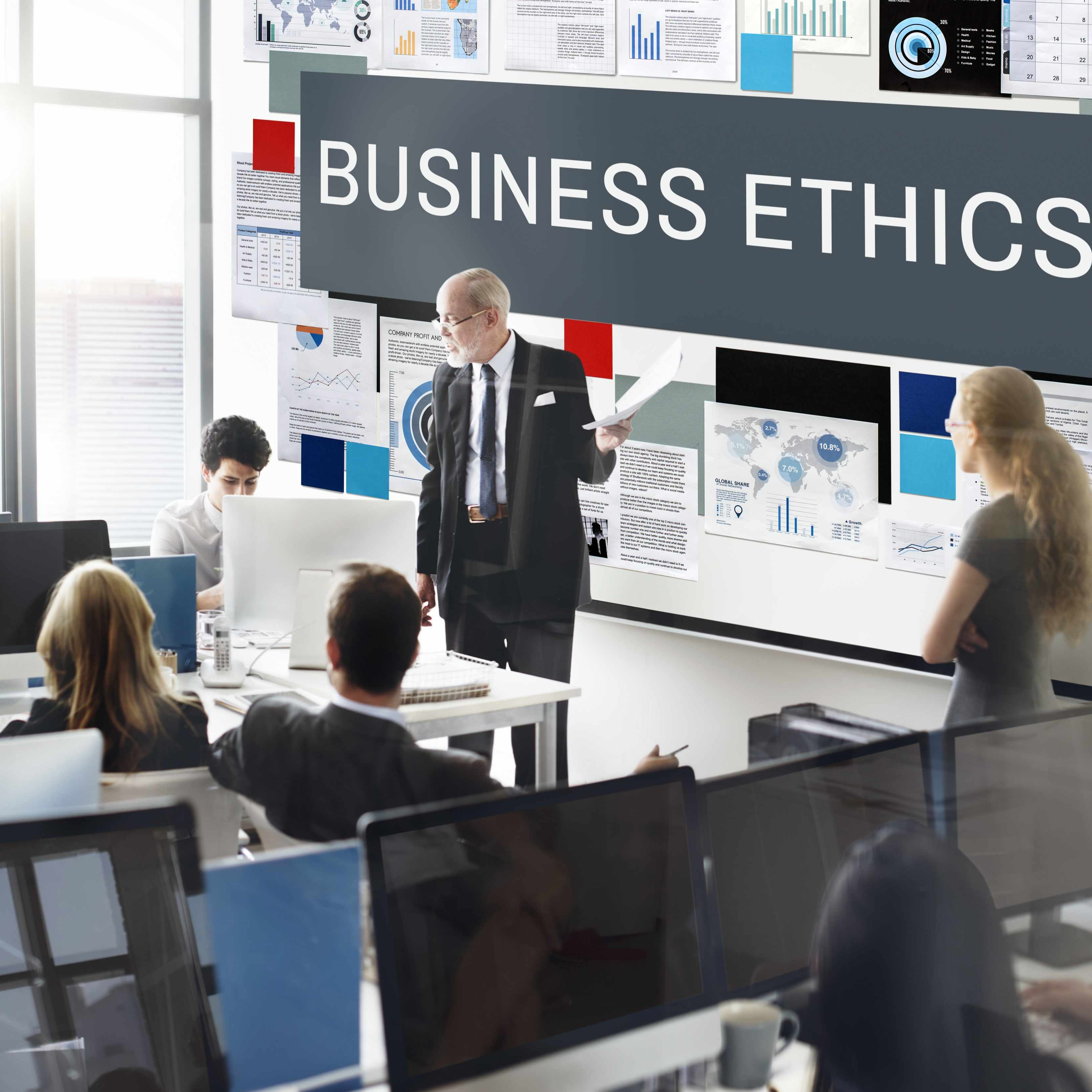 an office full of people attending a business ethics class