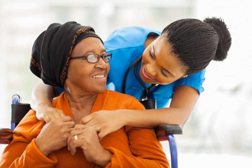 woman caregiver with older African-American woman diversity Alzheimer's