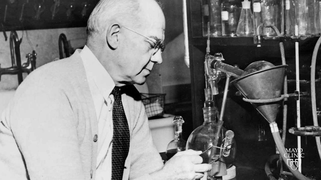A black and white photo of chemist edward kendall in a lab.