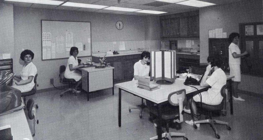 a 1967 photo of Myrna Jennison, Hazel Myers (supervisor), Sandra Schaefer, Kathleen Bingham and Diane Atkinson working in the Rochester Methodist Hospital history desk area