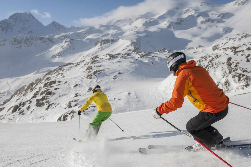 two people skiing down a snow-covered mountainside