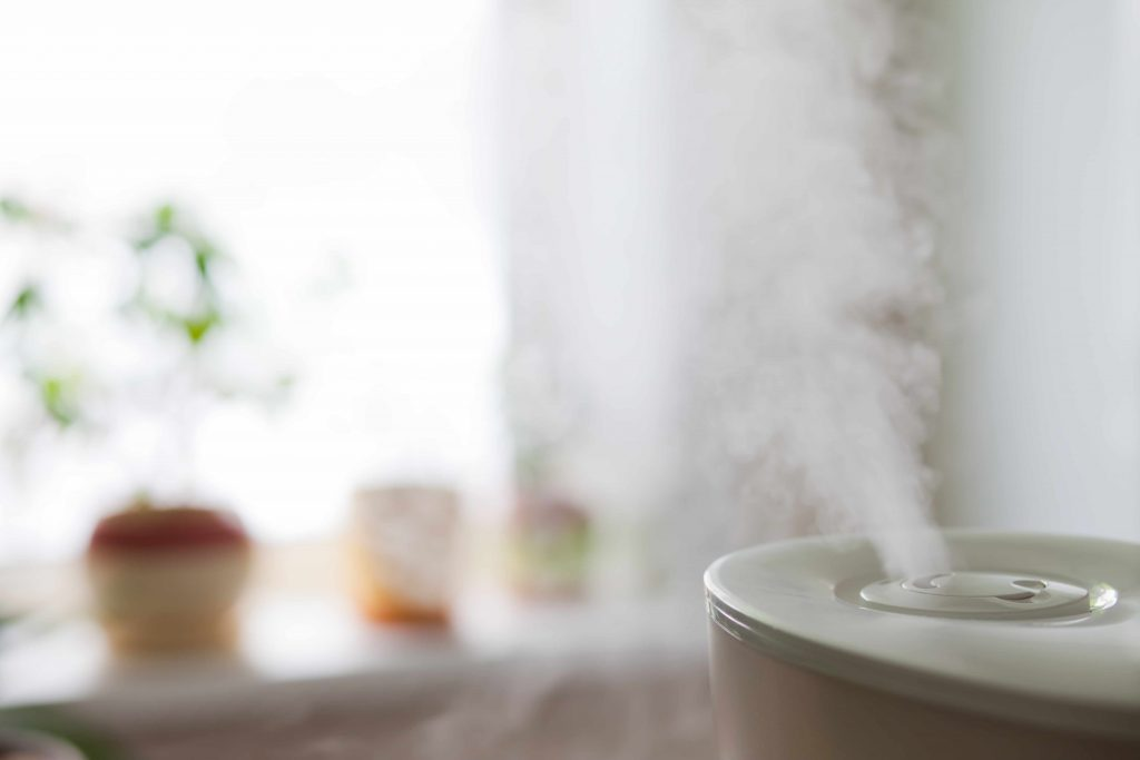 a humidifier emitting moist air into a room