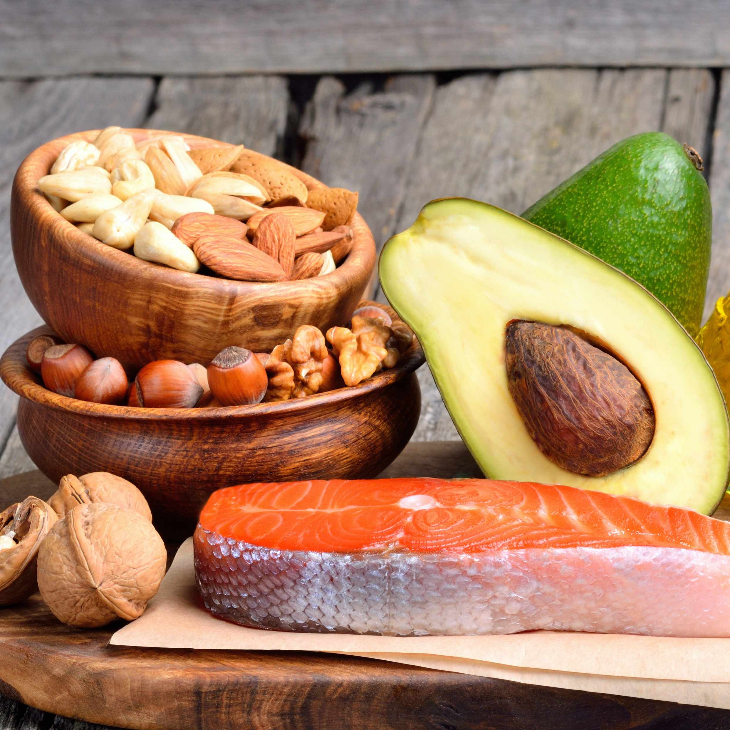 wooden tray of protein foods, fish, nuts