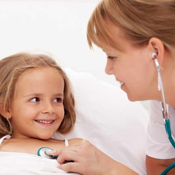 Little girl being checked by friendly health professional with stethoscope