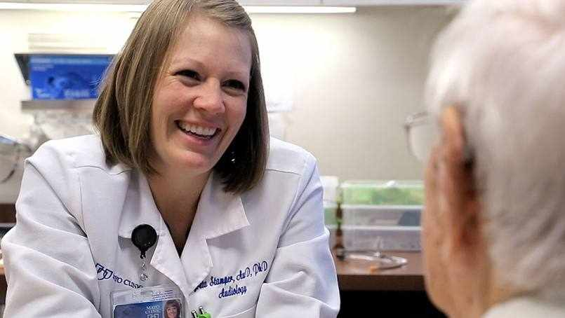 Greta smiling and talking with patient