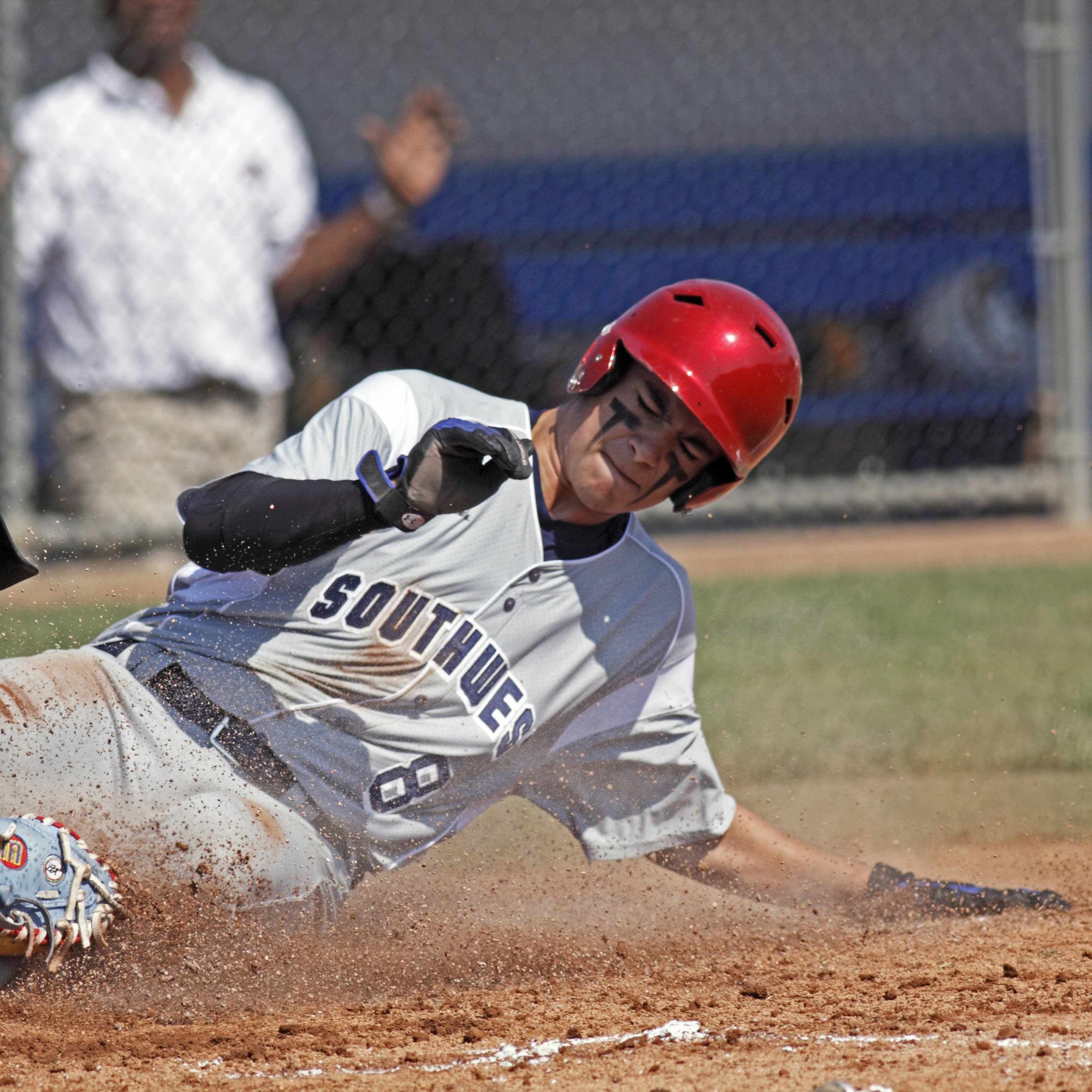 a baseball player sliding into a base on the field