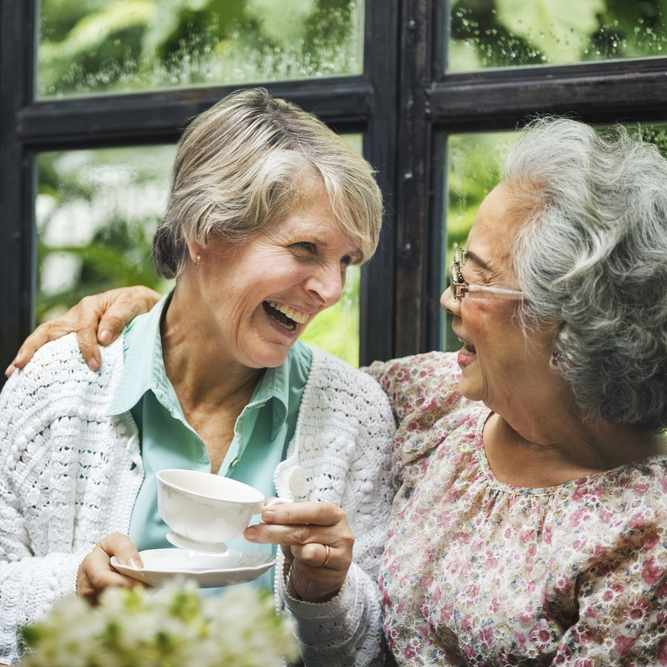 two older women talking and laughing together