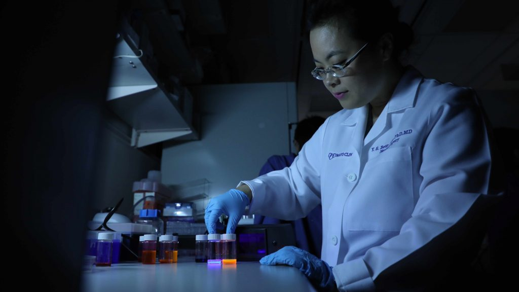 Dr. Betty Kim working with nanoparticles in her Florida lab.