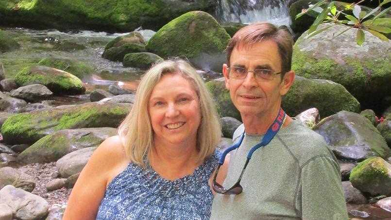 Sharing Mayo Clinic patient Robert Gall and his wife Maureen outside by a water stream