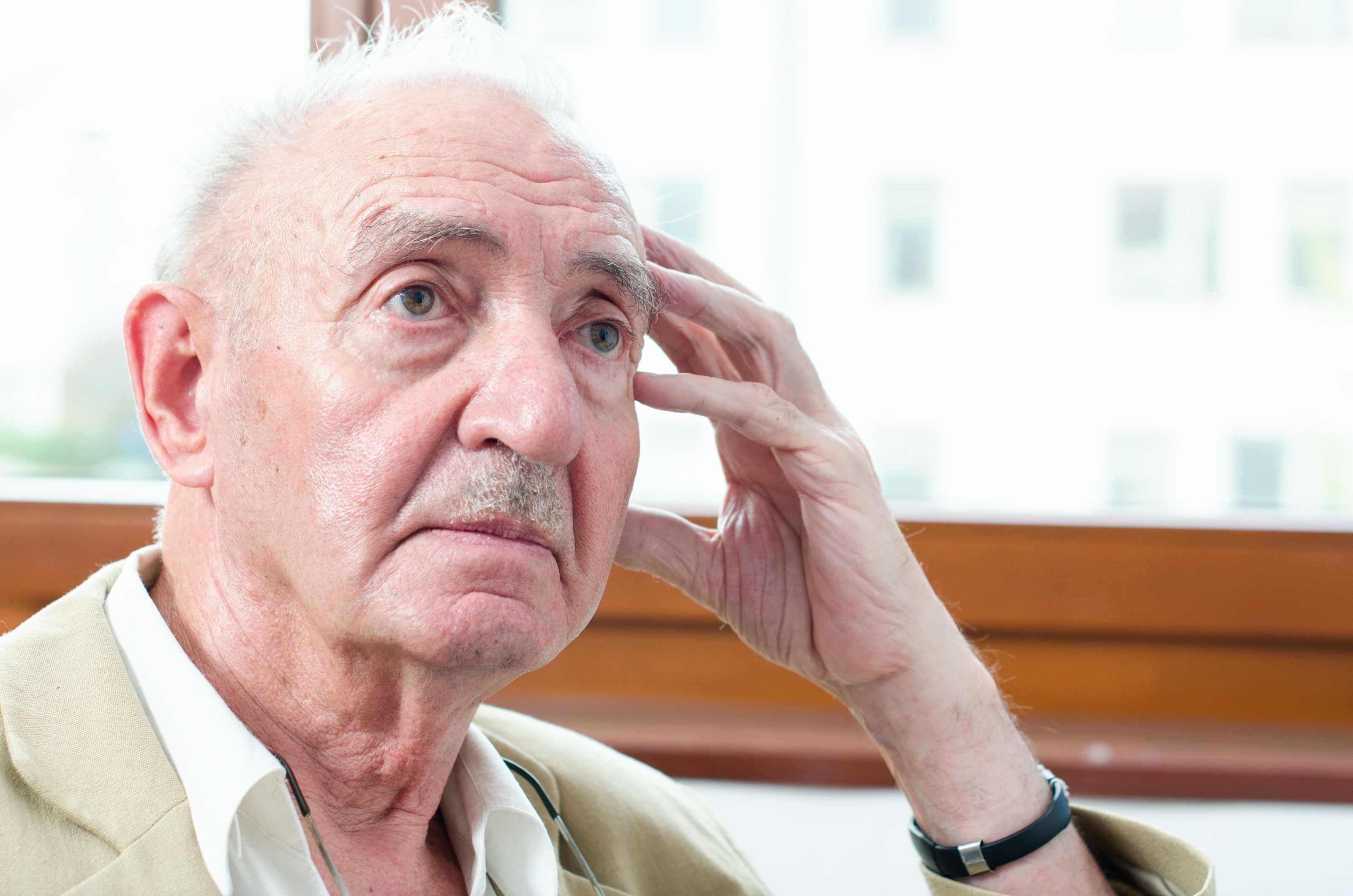 portrait of a senior man thinking