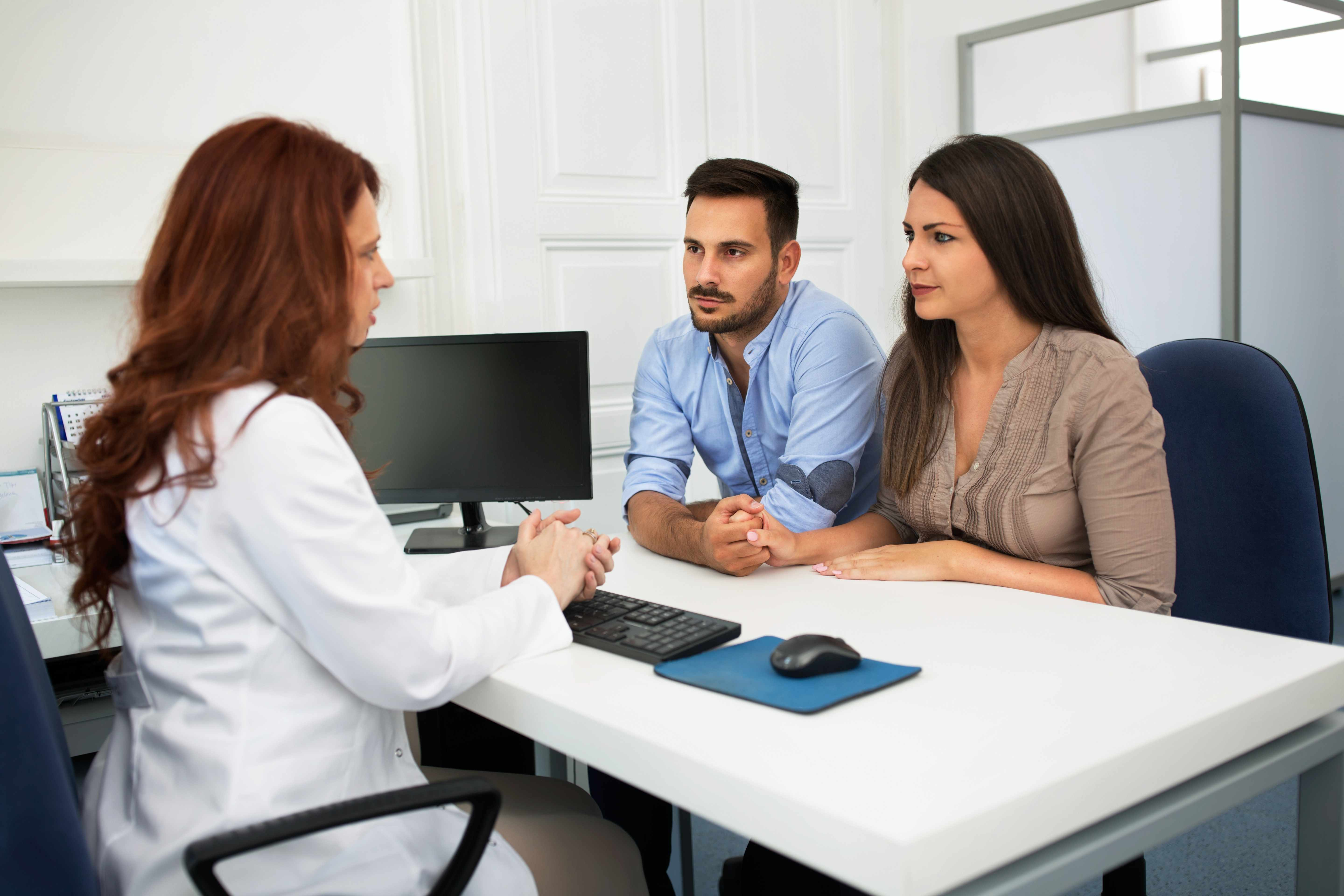 Young Hispanic couple with physician