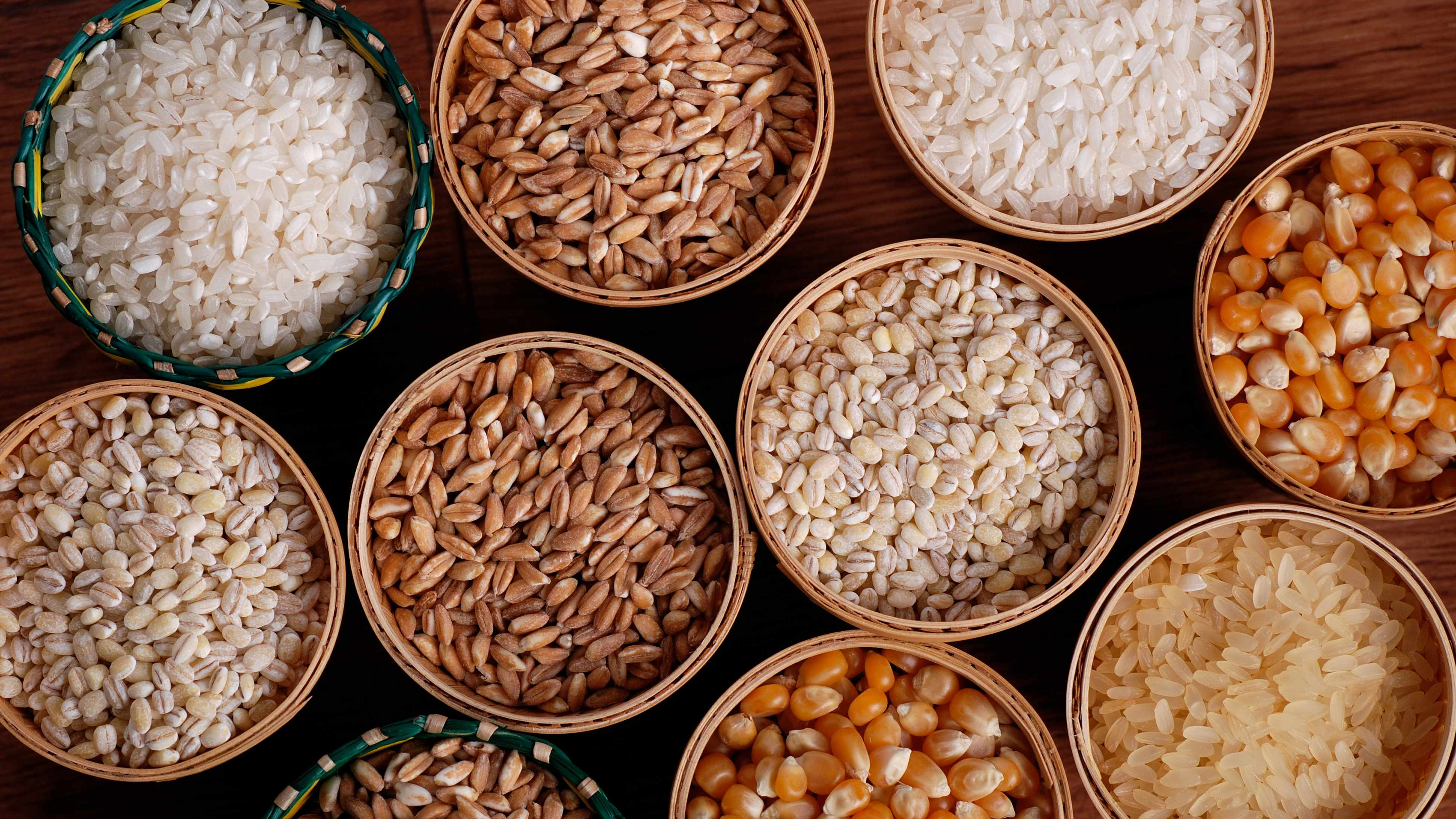 a group of small bowls filled with rice and whole grains