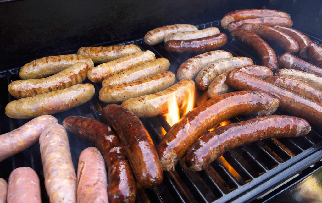 processed meat on a grill, hot dog sausages