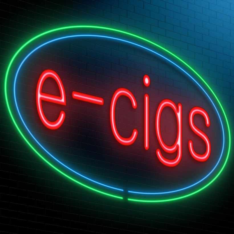 a neon sign saying e-cigs, advertising e-cigarettes