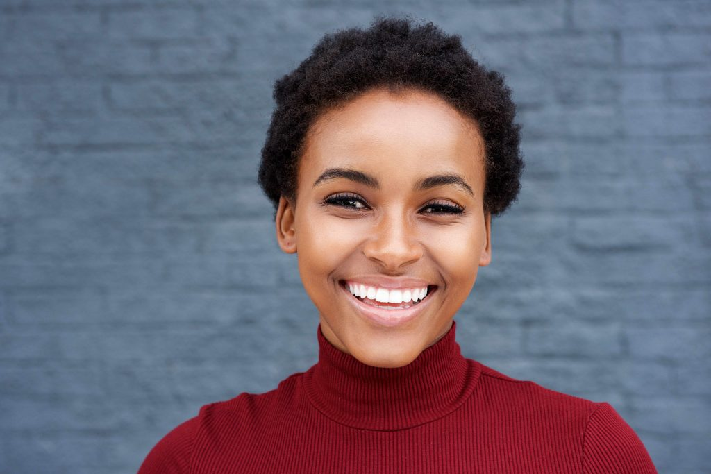 a happy young woman with a big, beautiful smile and especially white, healthy-looking teeth