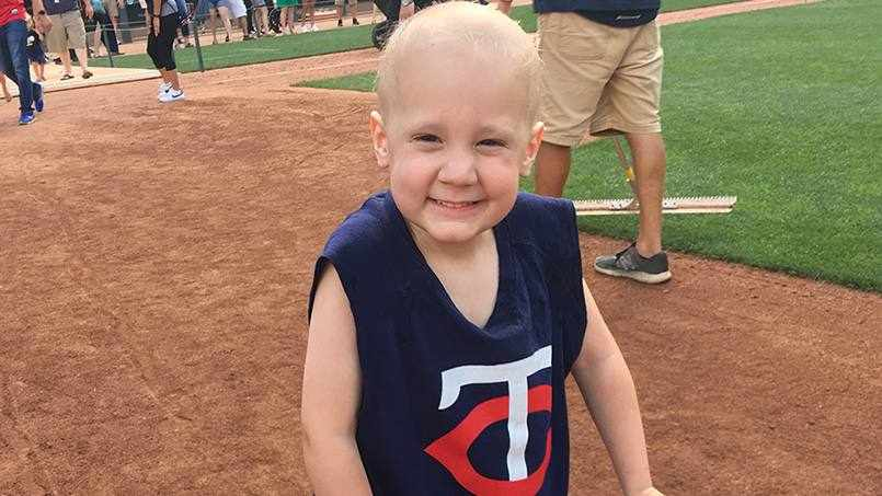 four-year-old Knox Olafson on the Twins baseball field smiling
