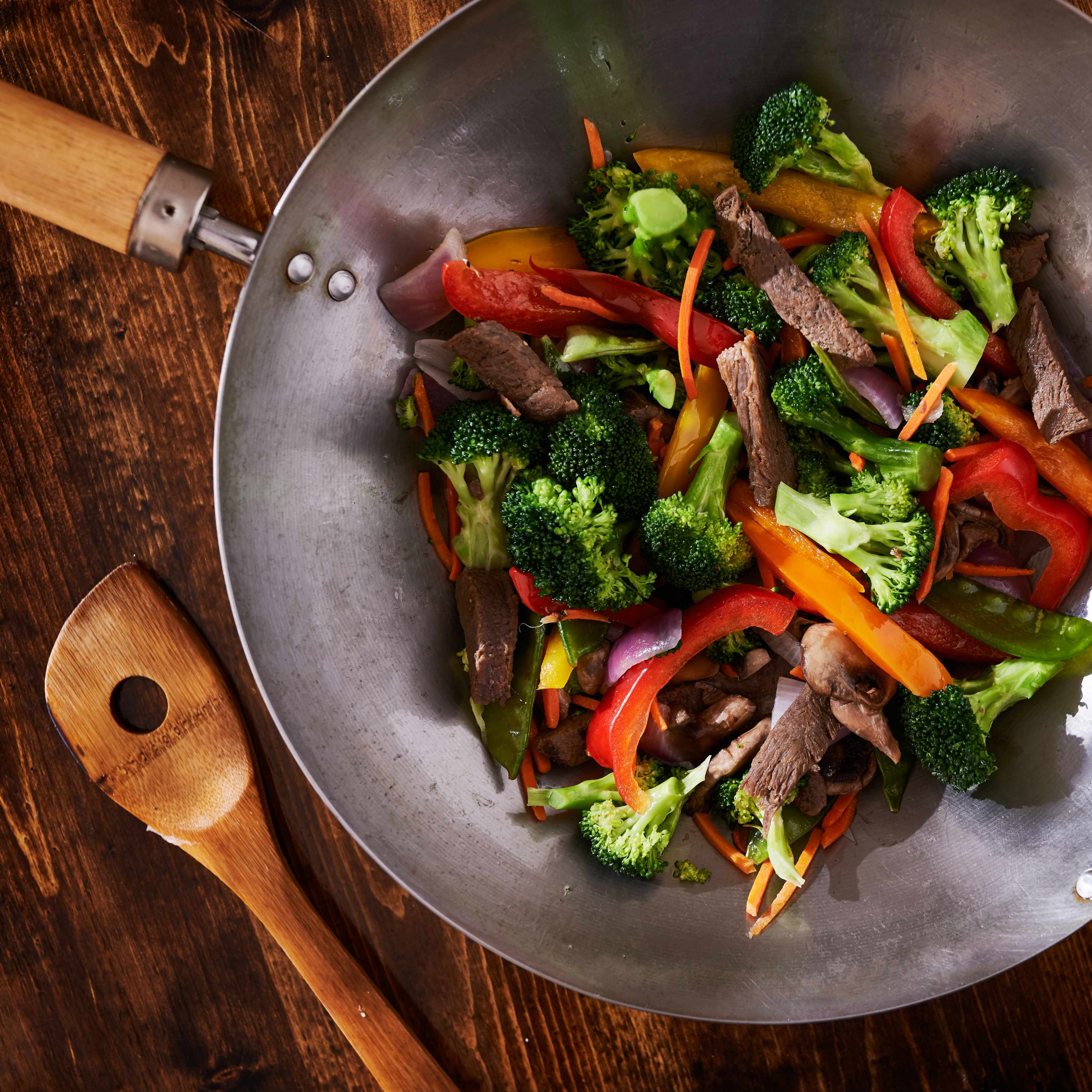 beef and vegetables in a stir fry wok