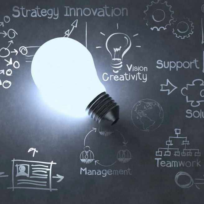 chalkboard with light bulb representing strategy and ideas
