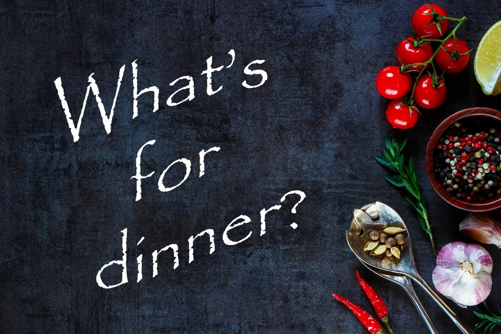 a chalkboard with garlic, tomatoes, peppers and other food along the edge and the words What's for Dinner?