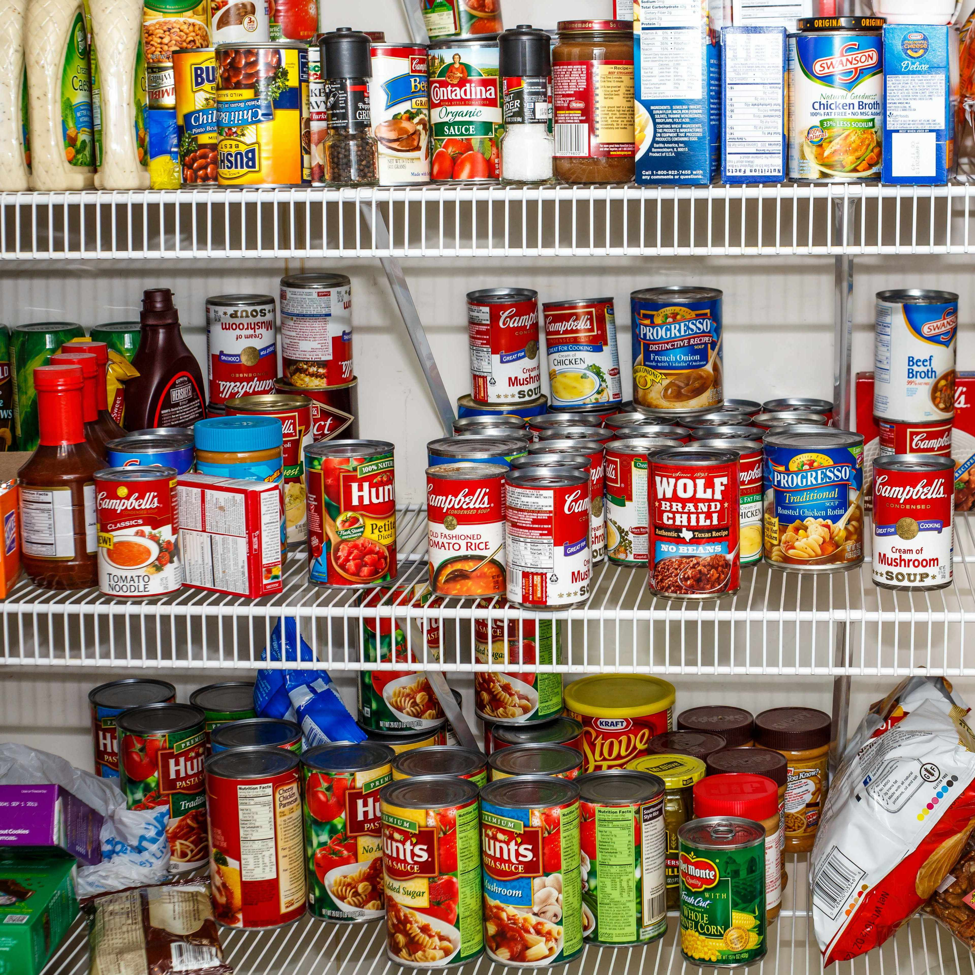 kitchen pantry shelf filled with canned foods and packaged items