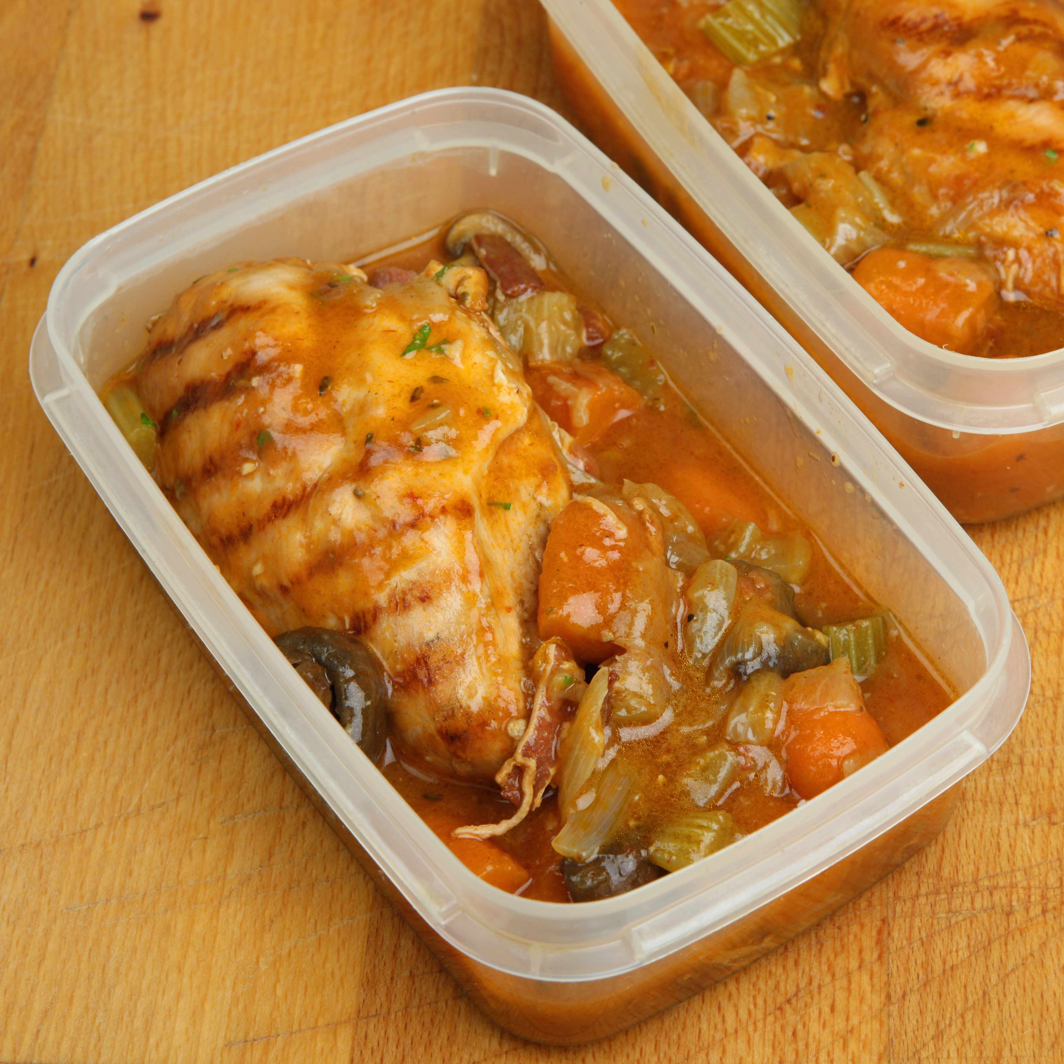 marinated chicken with vegetables and seasoning in a freezer or refrigerator container