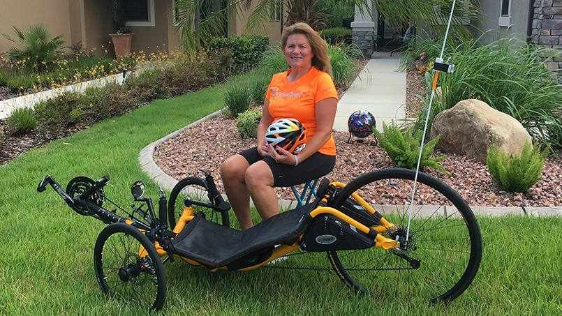 Sharing patient Julie Frisby sitting outside near her bike