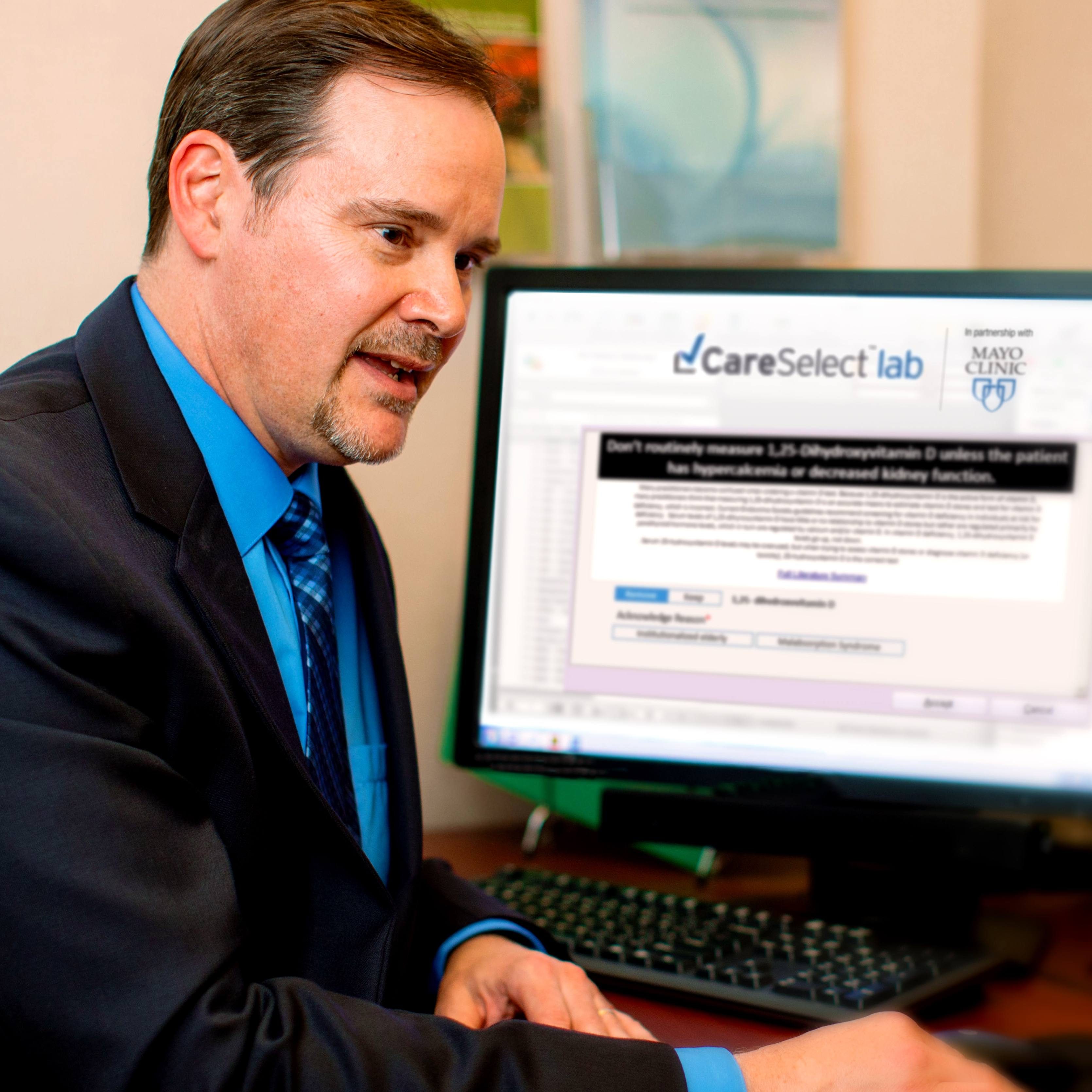 Physician working with patient using CareSelect Lab tool