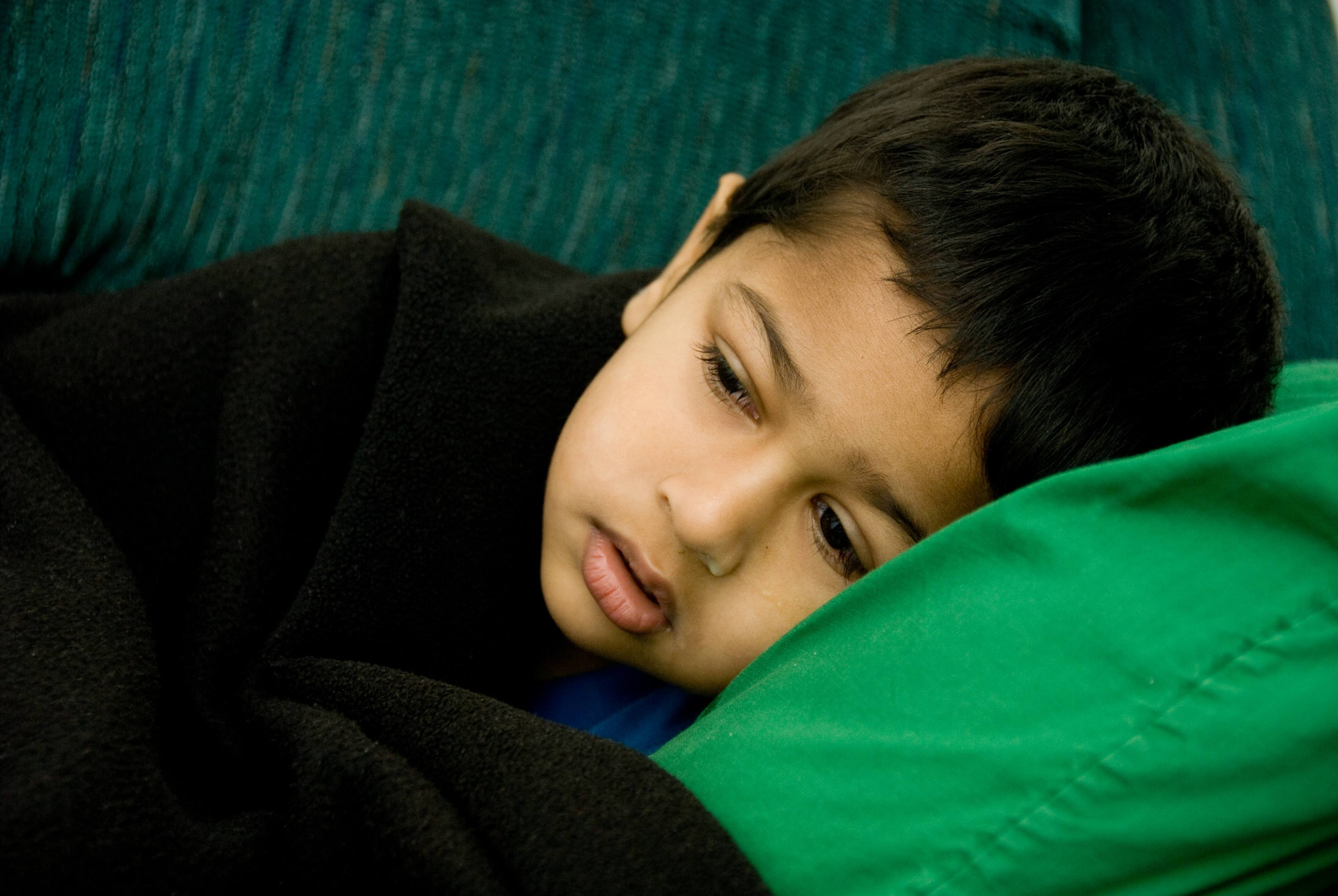 A handsome sick boy resting