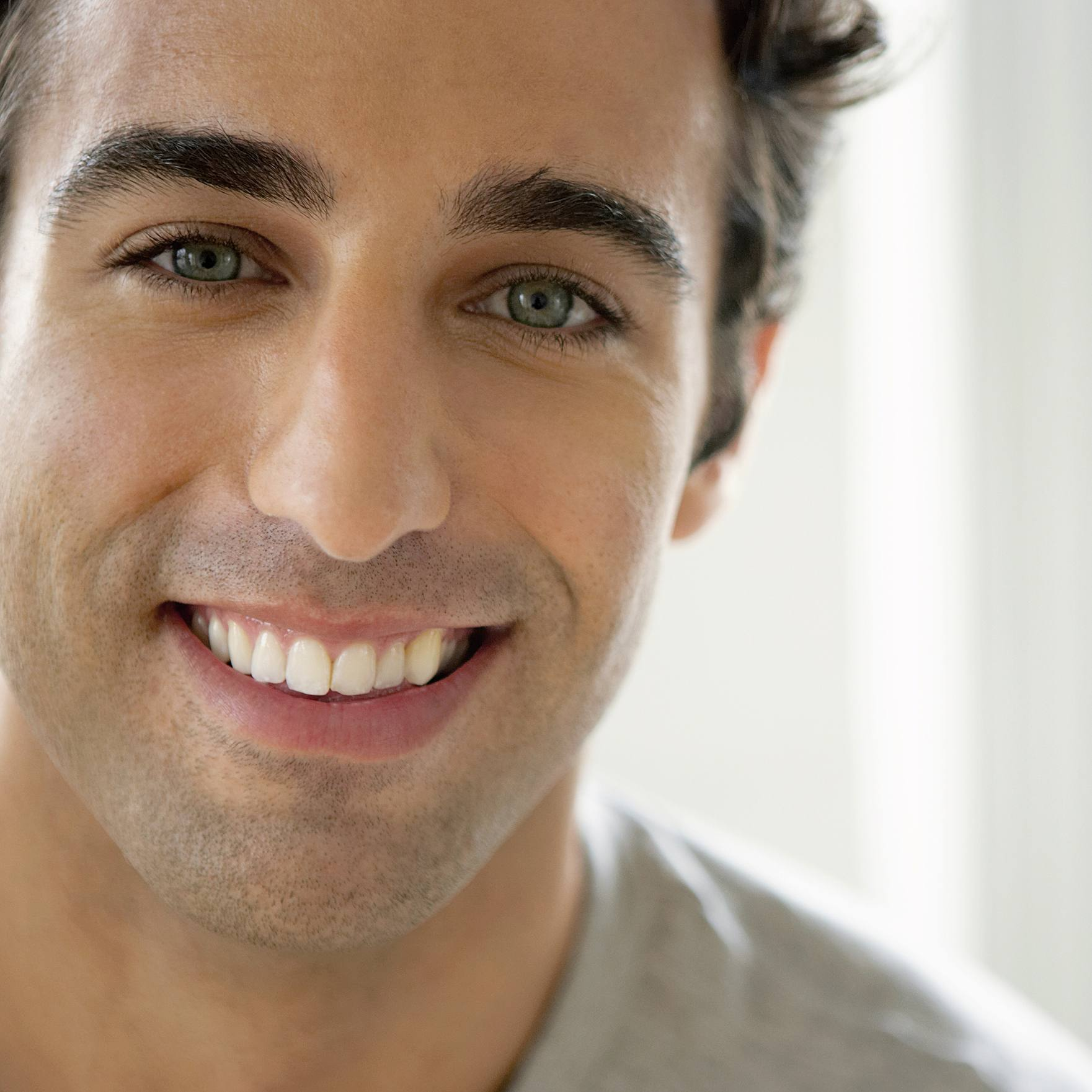 a close-up of a smiling young man