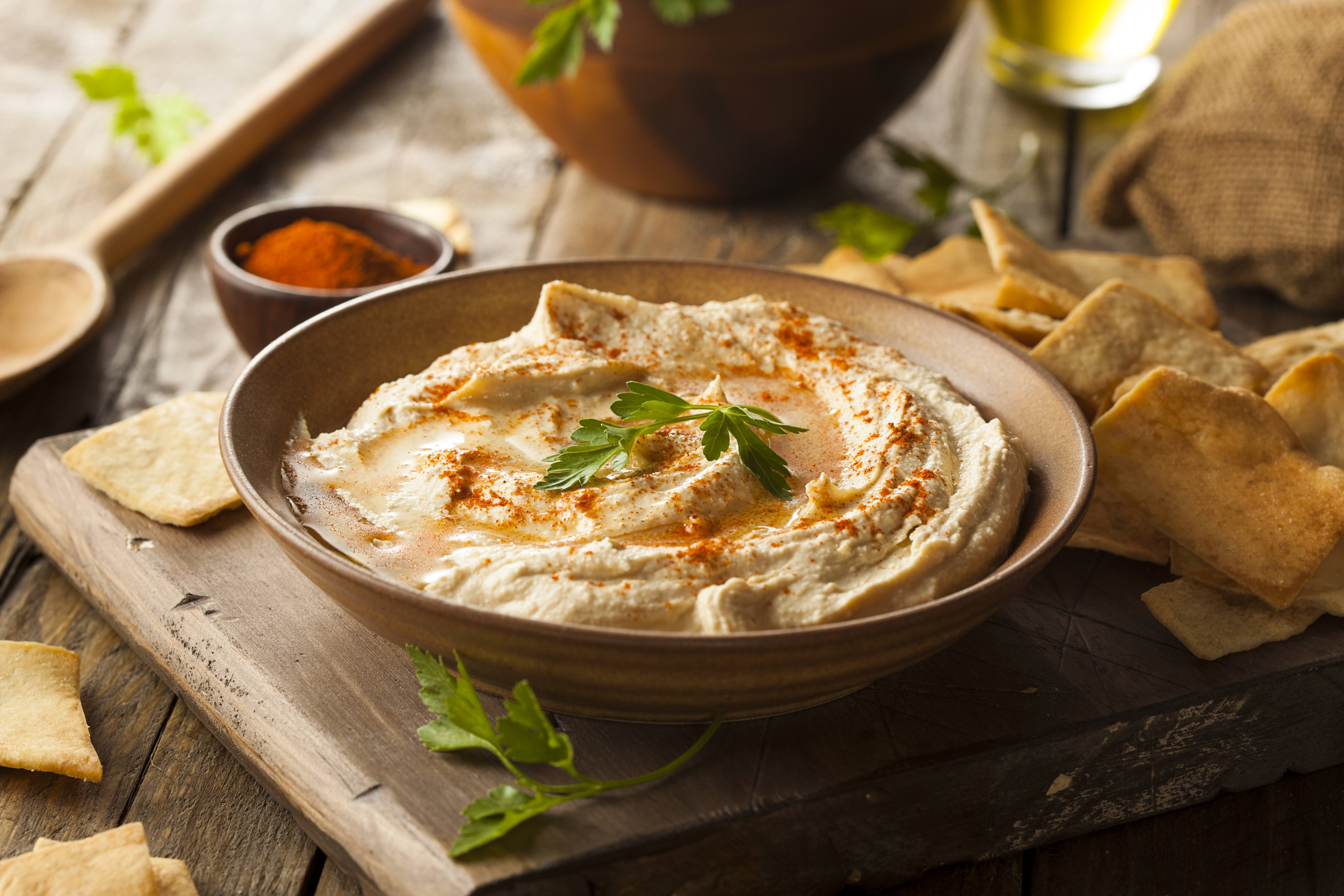 an appetizer bowl filled with a healthy hummus snack