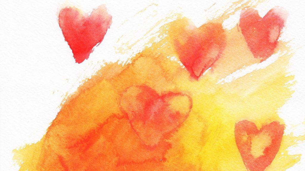 Acuarela de un corazón en amarillo, naranja y rojo