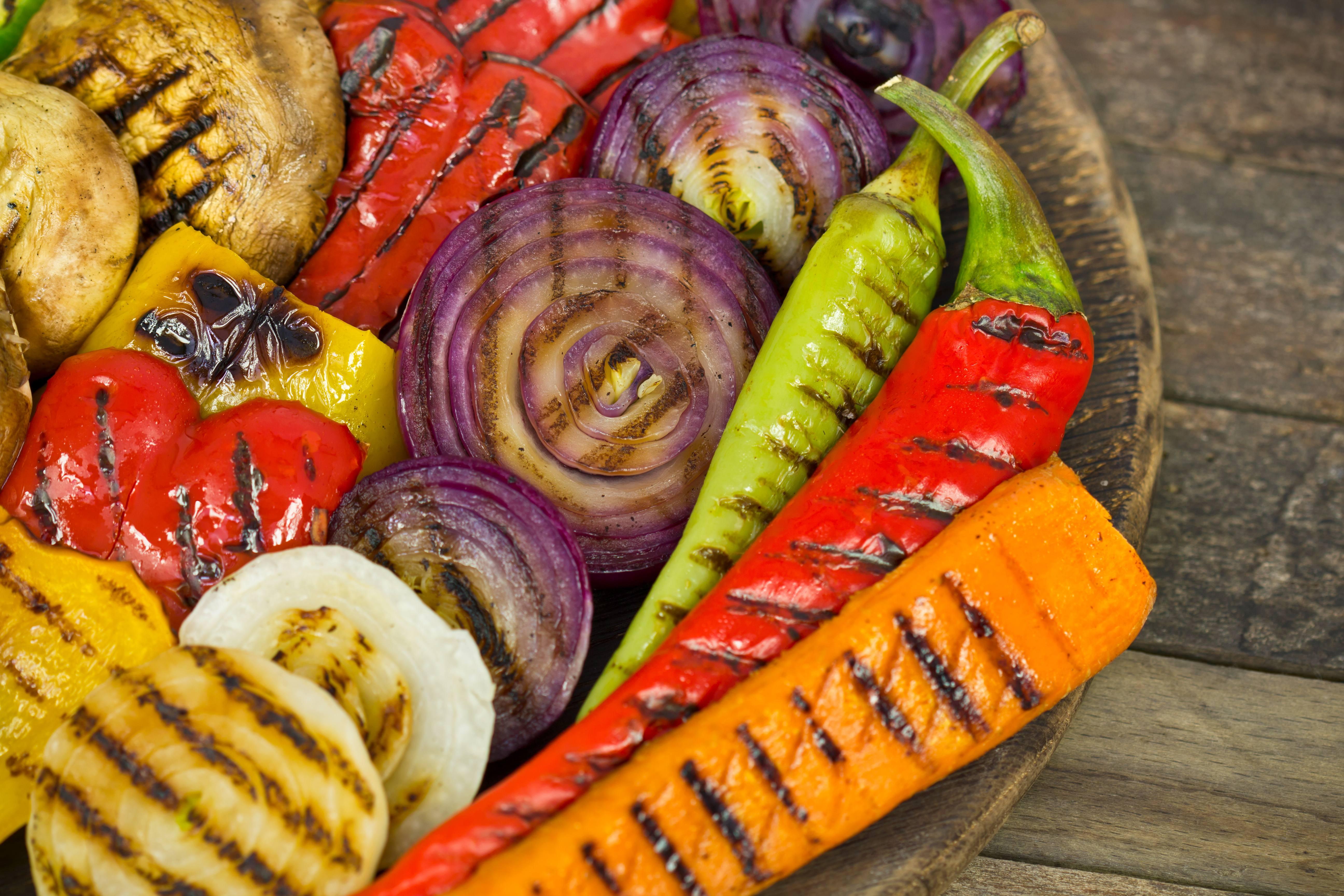 a wooden bowl of freshly roasted vegetables