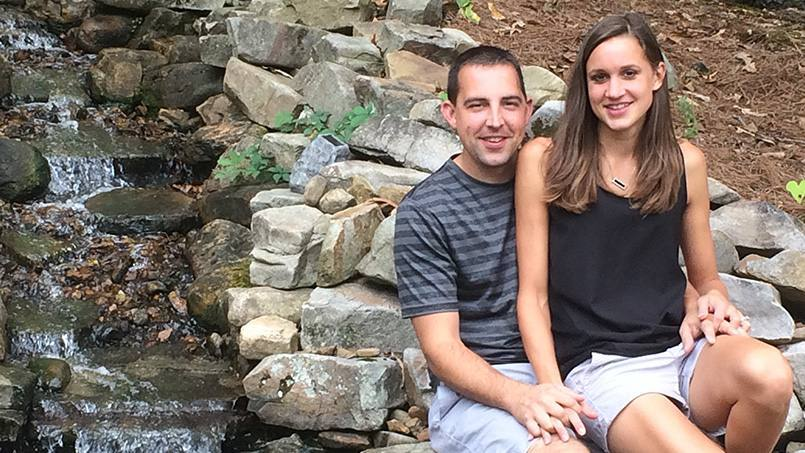 patient who had night seizures, Evan Bachtold and his wife Rachel smiling and sitting together near a stream on a pile of rocks 16x9