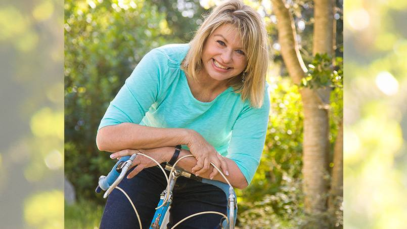 mastectomy patient Margaret Pelikan on a bicycle