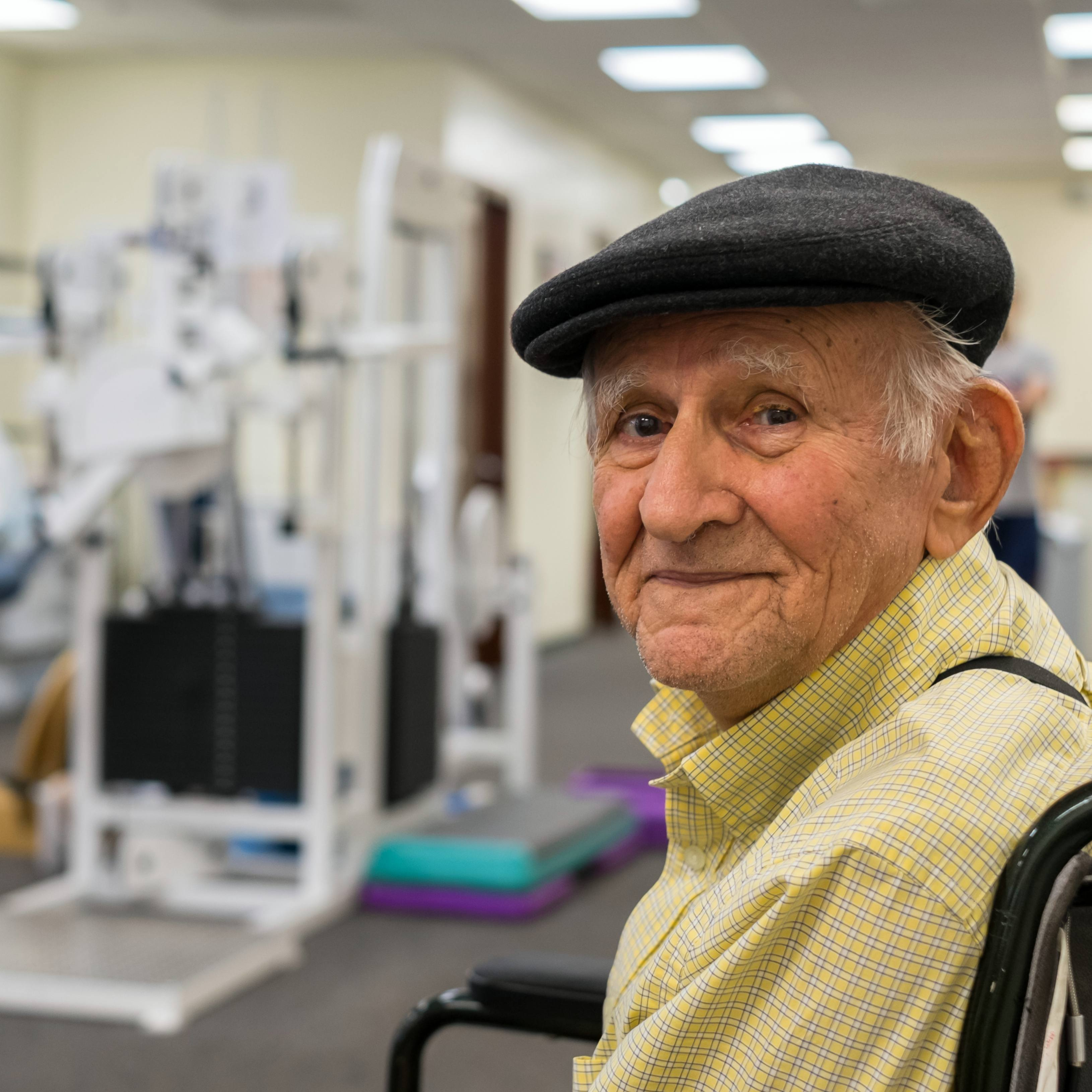 Elderly man receiving physical therapy