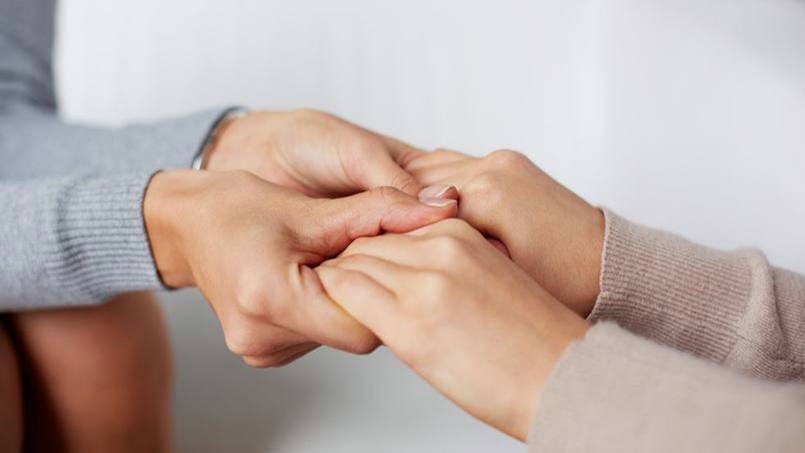 caring hands holding each other for comfort