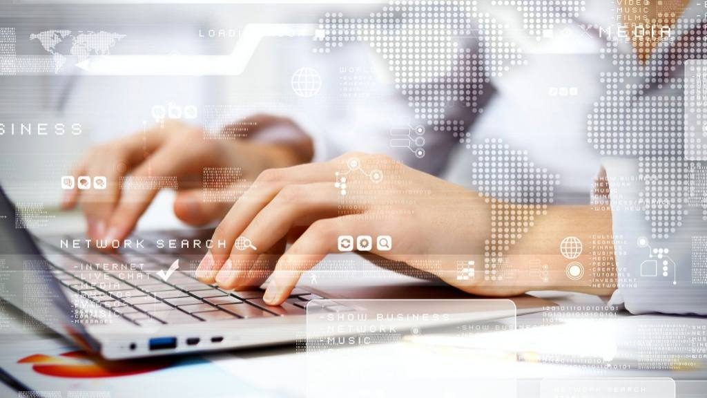 person working on computer against technology background