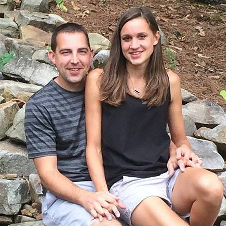 patient who had night seizures, Evan Bachtold and his wife Rachel smiling and sitting together near a stream on a pile of rocks