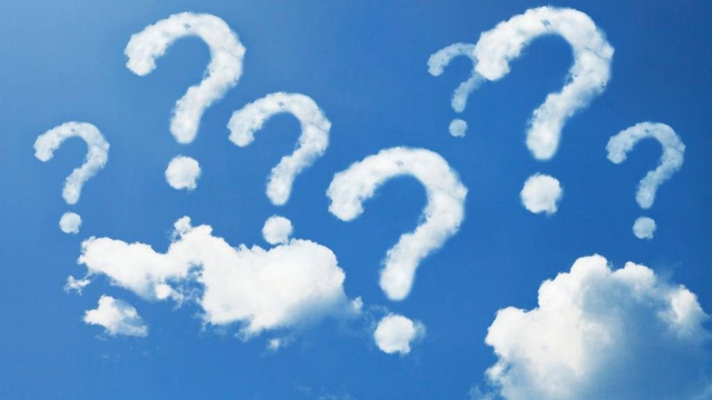 Blue sky and clouds in the shape of question marks