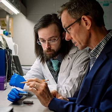 Dr. Jan van Deursen in the lab working with his graduate student