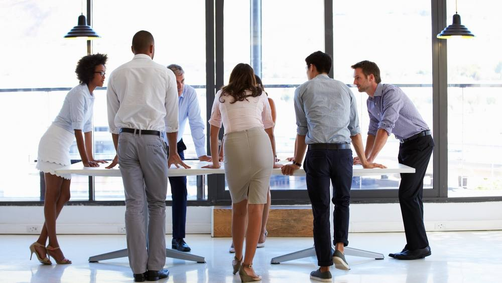 Diverse group of work colleagues standing