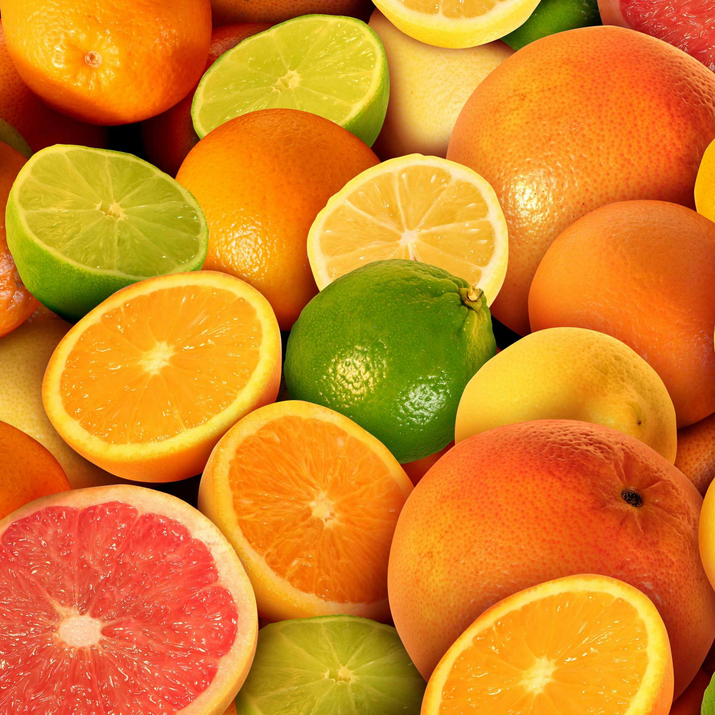 a pile of citrus fruits, oranges, lemons, limes and grapefruits