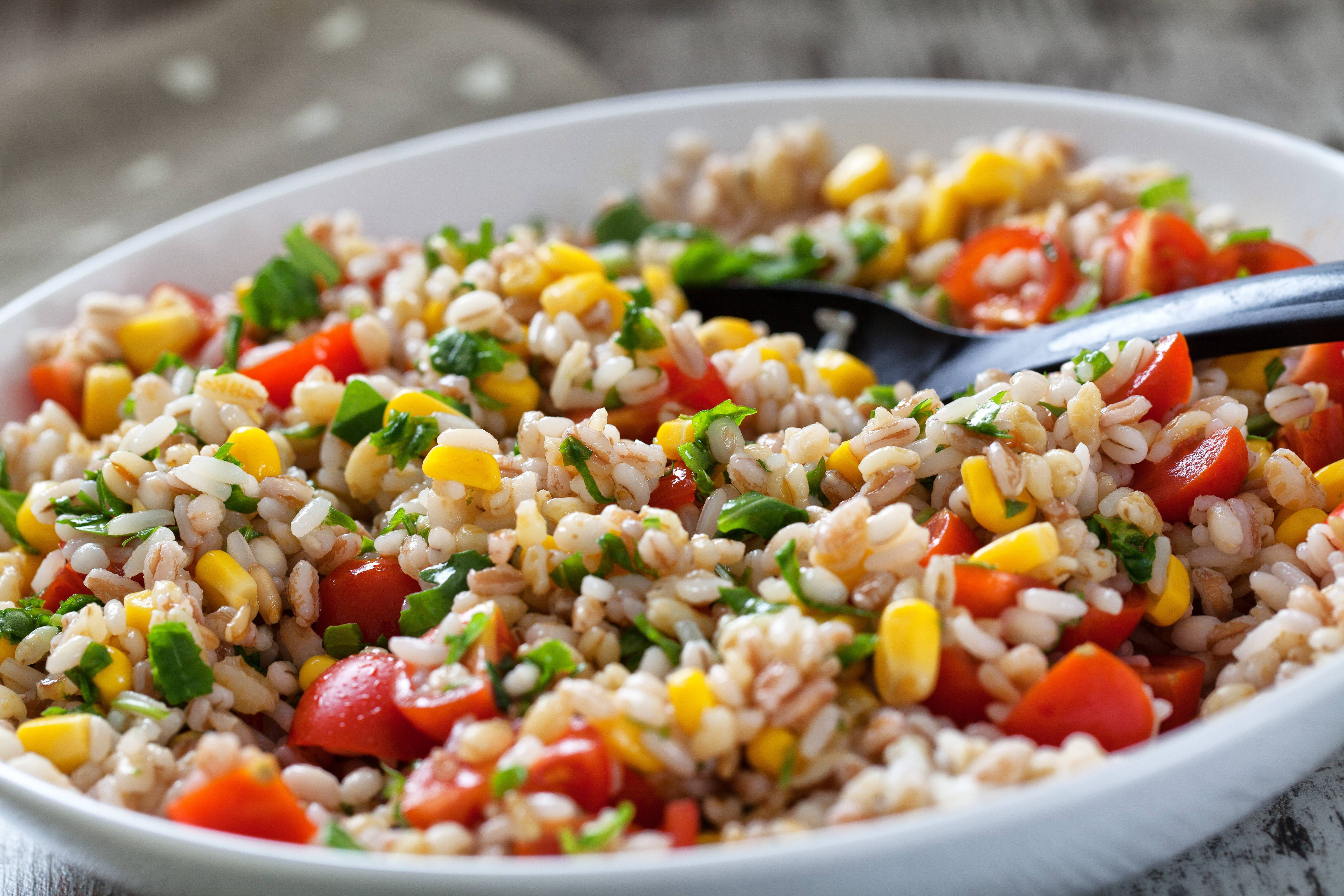 a bowl of orzo pasta with fresh vegetables